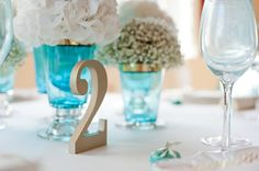 Teal and Gold Wedding Inspiration styled by Linen and Silk Weddings w/Boutique Bloom, Eagle Eyed Bride. Gold table numbers by EEB- photography by Fiona Kelly Photo: http://linenandsilk-weddings.com/2013/05/17/linen-and-silk-inspiration-a-teal-and-gold-wedding-shoot-by-fiona-kelly/