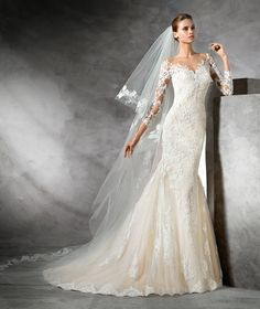 Spectacularfit and flarewedding dress that flares out at the bottom. It has 3/4 sleeves with gorgeous floral lace and guipure motifs all over the body of this romantic dress. Simply marvelous!