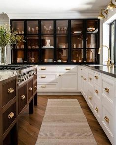 """Pulling so much inspiration from this counter to ceiling metal-framed cabinetry. The mix of finishes in this space adds so much visual interest while the wall of glass is reminiscent of a curio cabinet; allowing your """"good dishes"""" to take center stage.Bonus: This modern approach to open shelving comes without all the dusting. Home, Home Kitchens, Kitchen Remodel, Kitchen Design, Kitchen Inspirations, Kitchen Interior, Dream Kitchen, Cabinetry Design, House Interior"""