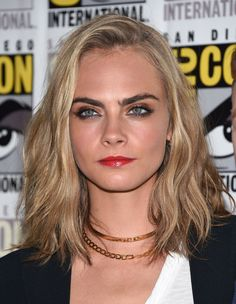 Cara Delevingne debuts new haircut at Comic-Con after posting Instagram pic of shorn locks