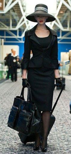 stunning black suit hat traveling