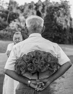 Man hiding bouquet of flowers for his wife.