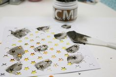 Creative Medium used to make stars with a star stencil. Creative Medium can be stamped with pigment or solvent inks once dried.  Creative Medium readily accepts glitter, inks and other additives when still wet. Use on canvas, metal, wood, plastic, glass, cardstock, tile, acetate and shrink plastic.  Easy clean-up. Water-based; archival and acid free. Conforms to ASTM D-4236