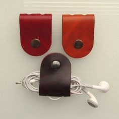 Earbud / earphone / cable organizers in red , mahogany and rust veg tanned leather handmade by RinartsAtelier