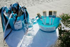 a great idea for a beach wedding, paint brushes, very practical to help brush the sand of the feet.