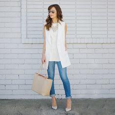 sleeveless white blazer.