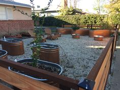 Large Scale Container Garden with Galvanized Tanks in the Neighborhood   A Gardener's Notebook