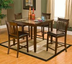 Capitola Faux Marble 5 Piece Pub Set (With 1 Table And 4 Chairs) by Alpine Furniture. $449.00. Espresso finish. Made from rubber wood solids. Includes pub table and four stools. Six months warranty. Faux marble table top. 554 Includes: -Set includes pub table and four chairs. Construction: -Rubberwood solids and faux marble top construction. Color/Finish: -Espresso finish. Assembly Instructions: -Assembly required. Dimensions: -Table dimensions: 36'' H x 42'' W x 42'' D.-Chai...