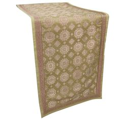Indian Table Runner Size: 139 x 33 cmsMade of top layer of brocade and silk fabric inner layer of handloom cottonHandmade by weavers of Varanasi.Used as Table Runner, on dresser and on coffee tableDry clean only.This item can be shipped to