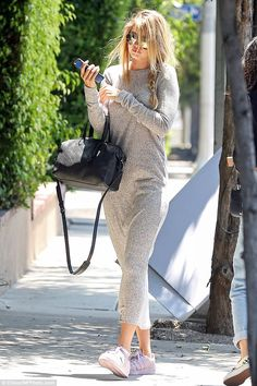 Casual chic: The model displayed her relaxed style with a grey dress and white sneakers ...