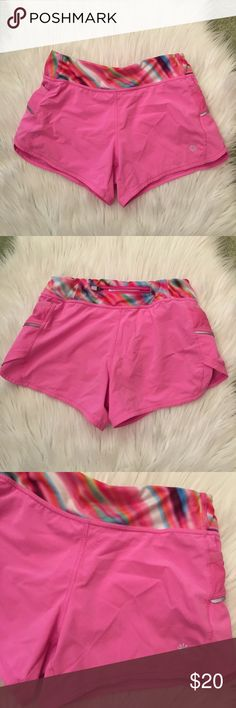 Athleta Girl Pink Shorts Great pair. Size Medium 8-10. Stretchy waist. Amazing quality. In good condition!! Athleta Bottoms Shorts