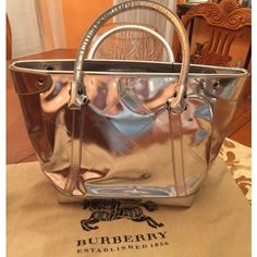 Burberry silver bag Burberry mirror silver leather zipped up tote, size is 17'x 12', new with the tag and a dust bag! Made in Italy, Beautiful bag!! Burberry Bags Totes