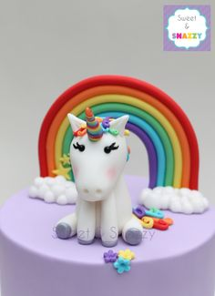 Rainbow Unicorn cake topper - fondant unicorn and rainbow cake toppers by Sweet & Snazzy https://www.facebook.com/sweetandsnazzy