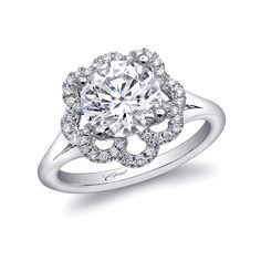 This graceful floral engagement ring features diamond petals and a high-polished split shank. Created for a 2CT center stone. Marshall Jewelry