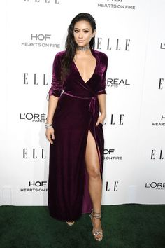 Shay Mitchell kills the red carpet game with a plunging, deep purple dress for ELLE Women in Hollywood awards.