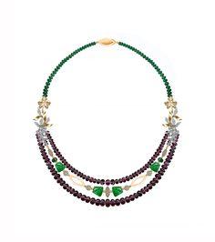 tourmaline beads,carved columbian emeralds ,diamonds and uncut diamonds set in silver