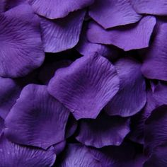 """Loose silk rose petals in stunning purple. 100 petals per bag that measure 1.75-2.25"""" in diameter each. Perfect for decorating table tops or to be used for flower girl baskets. Petal Decor Guidelines"""