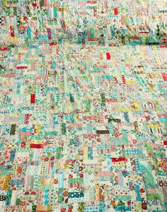 awesome scrap quilt, like a where's waldo you could find so many little things in there if you look hard enough