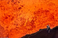 Like the surface of the sun: Getting to within just 30m of the molten lava, Geoff Mackley has become the first person ever to get so close to the centre of this volcano