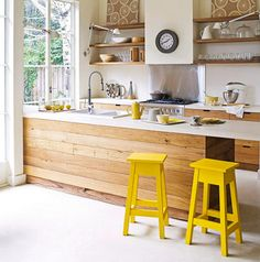 yellow stools, floating timber shelves. From real living magazine