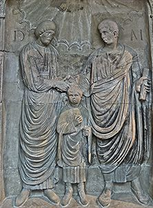 Detail of relief on front of large family tomb monument from Neumagen depicting husband and wife clasping right hands over head of young son (Roman, 3rd century CE)