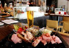 Bohemian Misto Board with pickled vegetable and beer bread; Black pork ham, Prague ham, speck, smoked bacon and tlačenka