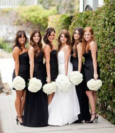 Mismatched black bridesmaid dresses with white hydrangea bouquets. #black and #white #wedding