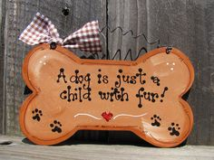"Wooden sign - ""A dog is just a child with fur."" $5.00, via Etsy."