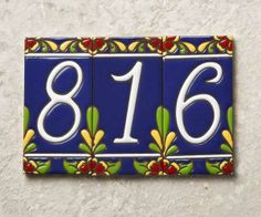 Hand-painted Talavera-style details highlight curvy white house numbers on a deep blue backdrop. Cost: $10 per tile from lafuente.com. | Photo: Andrew McCaul | thisoldhouse.com