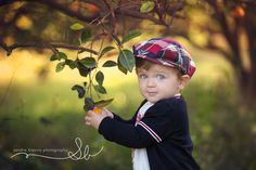 Awwwe! Great shot! Boy in an orchard -Luca – South Florida Child Photography