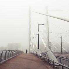 Through the foggy city by Vesa Pihanurmi Via Flickr: Walking across the bridge of Cruselli in Ruoholahti, Helsinki.