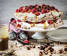 Chocolate Pavlova with Salted Caramel, Whiskey Sauce, Raspberries and Caramel Hazelnuts...