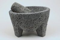 This molcajete is carved from natural lava rock.  This is one of the very few cooking utensils made from nature.  No cook can live without this, not to mention it looks great with fresh fruits and vegetables in it while not in use.  ($29.99)