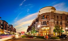 """""""Mayfaire Town Center"""" is a mixed-use town center in North Carolina that includes condominiums, a grocery market, a cinema, restaurants, office space, and retailers."""