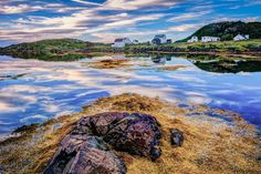 A calm evening and a low tide with some beautiful clouds at Salt Harbour Newfoundland Canada. Located near Twillingate Newfoundland, Salt Harbour is a picturesque little town found in central Newfoundland. Newfoundland Canada, Travel Ads, Landscape Photography, Reflection, Salt, Clouds, Mountains, Water, Outdoor