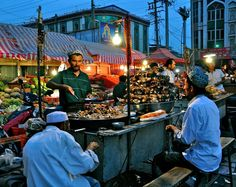 """""""An Uyghur man serves up goats' heads at the night market in Kashgar, Xinjiang province, China (1/2). Uyghurs are predominantly Turkic-speaking Muslims…"""""""