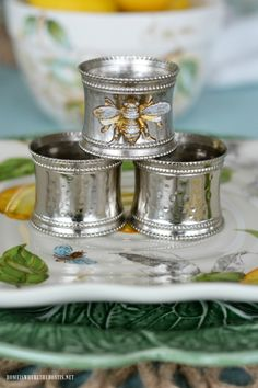 Transforming Napkin Rings with Magnets and Rub 'n Buff | ©homeiswheretheboatis.net #napkinrings #makeover #bees