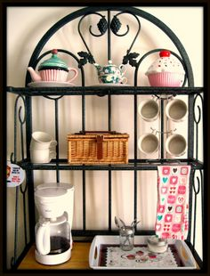 Coffee/tea bar? I have a bakers rack almost just like this!