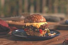 All-American Steakburgers recipe - Calling all steak lovers – this one's for you. Made with ground sirloin, these cheesy burgers are topped with grilled vegetables and served on whole wheat buns. Now that's what we call eating smart. #burgers #grilling