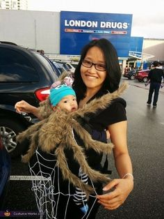 Tracy: My son and I are wearing our homemade spider and web costume. I was searching for costume ideas that would allow me to wear my son in an Ergo carrier...