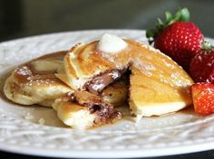Nutella Stuffed Pancakes 2 cups Original Bisquick mix 1 tablespoon sugar 2 teaspoons baking powder 1 cup milk 1 tablespoon vanilla 2 eggs Hazelnut spread with cocoa Heat griddle or skillet over medium-high heat