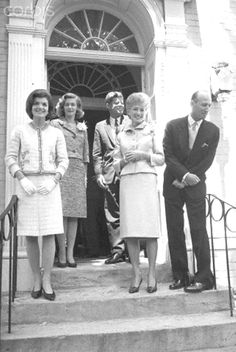 Angier Biddle Duke's Wedding Reception  Washington: State Department Chief of Protocol Angier Biddle Duke was married to Mrs. E. Chandler Tippett, of New York, in a civil ceremony in nearby Virginia. A reception was held at the home of Sen. and Mrs. Claiborne Pell, D-R.I. here after the ceremony. Pres. and Mrs. Kennedy were on hand at the reception. (Left to right): Mrs. Kennedy; Mrs. Pell; Kennedy; Mrs. Duke, and the Chief of Protocol. Duke is leaning over to greet a well-wisher  May 12…