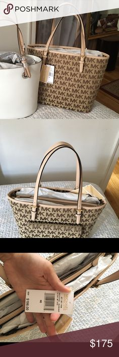 MICHAEL KORS TRAVEL TOTE Beautiful new bag. Perfect condition new with tags. Travel tote with built in laptop case. Michael Kors Bags Travel Bags