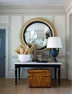 Entryway decor inspiration: crisp white board walls, and dark accents.