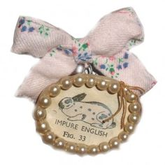 Handmade brooch by Julie Arkell using papier mache, stitched fabric and founds objects.
