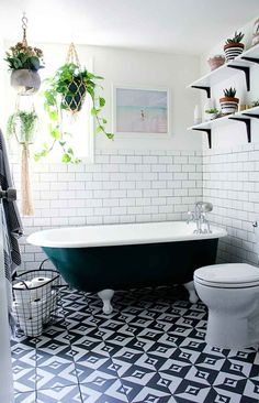 clawfoot bathtub and graphic tiles