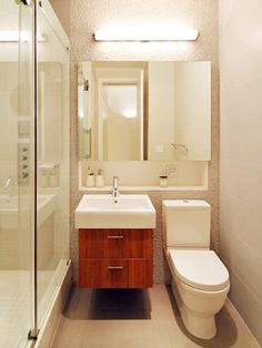 Turtle Bay Loft modern bathroom- I liked the cabinets under the sink- there is something neat and compact about the whole bathroom. Nothing fancy or no frills. Minimalistic with colored cabinet