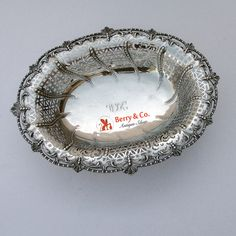 "English sterling silver large open work serving bowl with applied shells and scrolls, resting on footed base by Lambert &Co, having full set of London hallmarks for 1954. Monogrammed ""WJK""."