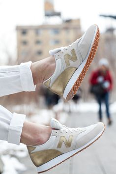 gold and white new balance sneakers