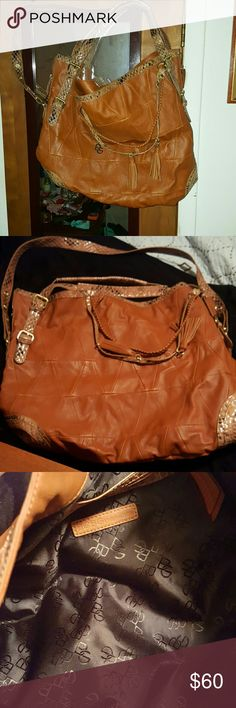 Very large fashionable tote Rich camel brown large bag double handled and a drop straps of 16 inches about 17 inches long by a foot high zips on each side go a quarter of the  way down lots of visual interest magnetic closure one inside zip pocket and 2 other side wall pockets great for stylish gym bag or diaper bag  or for someone who  likes big bags BCBGeneration Bags Shoulder Bags